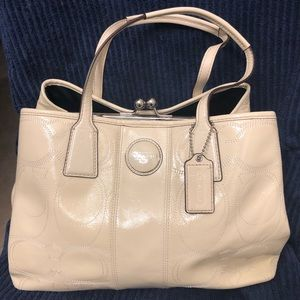 Off-white patent leather Coach purse.